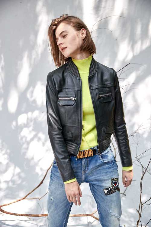Dark green geometric cut leather coat