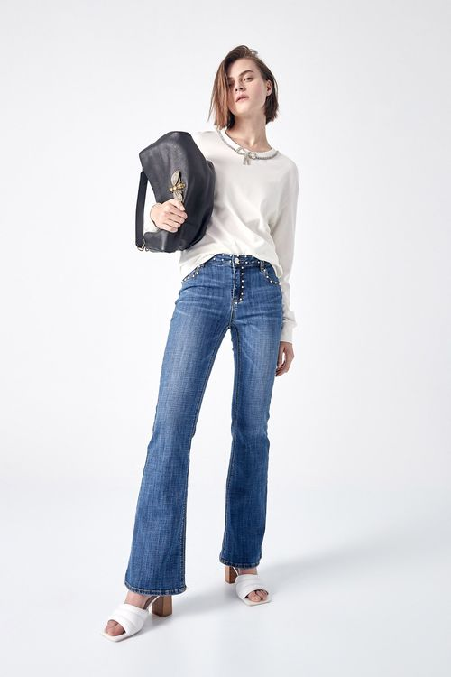 Flared jeans with pearls decoration