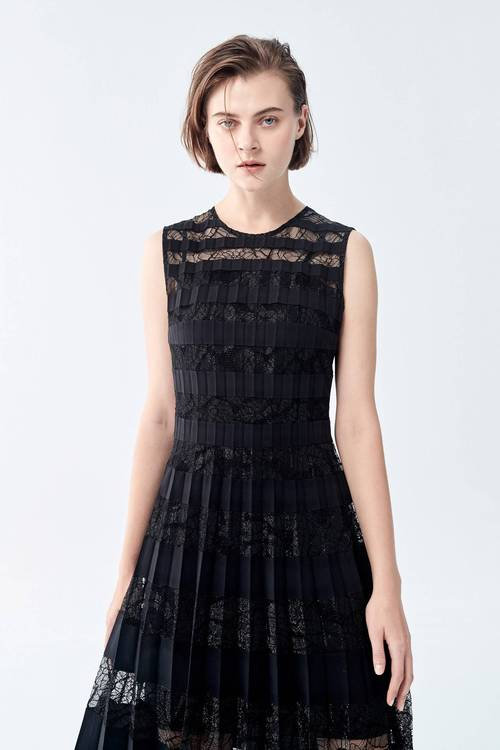 A disso-material stitched long dress.