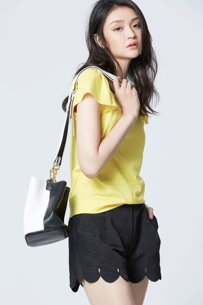 Bright yellow top with puff sleeves